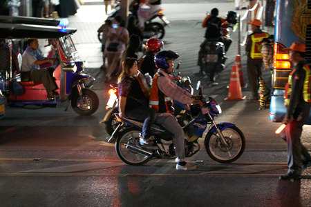 BANGKOK, THAILAND - July 21, 2017: Road traffic in Bangkok downtown. Noisy and colorful vehicles on the crowded streets at evening. 写真素材 - 103203212