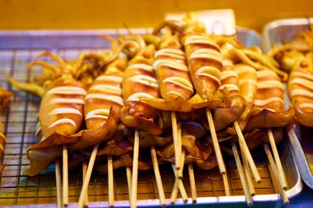 Ready to eat fried squids. Фото со стока