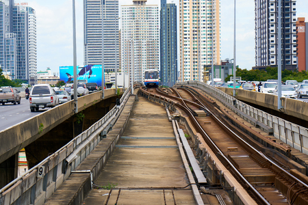 BANGKOK, THAILAND - July 14, 2017: BTS train on the railway on the bridge over Chao Phraya river. View from Saphan Taksin BTS station.