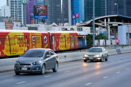 BANGKOK, THAILAND - July 23, 2017: Fully advertisement-wrapped  train departing departing from BTS skytrain station in Bangkok