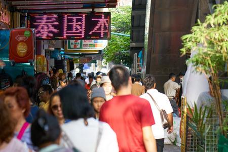 BANGKOK, THAILAND - July 22, 2017:  Crowd of people walking along market street. Asian city hustle and bustle. Editöryel