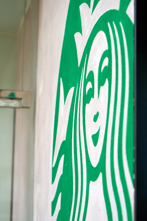 HONG KONG - September 2, 2017: Fragment of Starbucks coffeehouse chain signage painted on a stucco wall. Illustrative editorial.