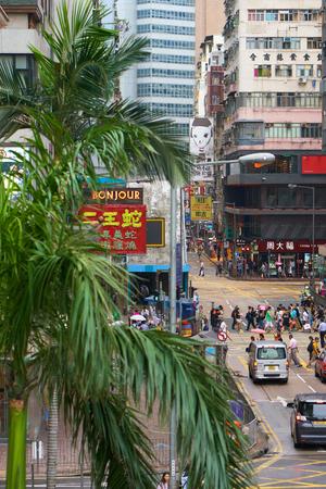 HONG KONG - September 4, 2017: View from top on pedestrians crossing road. Asian metropolis hustle and bustle. Street scene in Hong Kong.