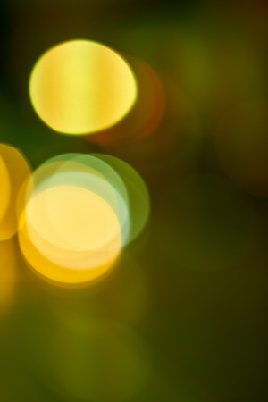 Out of focus view of night street lights. Abstract bokeh background.