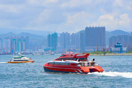 HONG KONG - JULY 1, 2018: High speed passenger catamaran Tri Cat (UNIVERSAL MK 2002) of Turbo JET ferry service company sailing from Hong Kong  to Macau in Victoria Harbour.