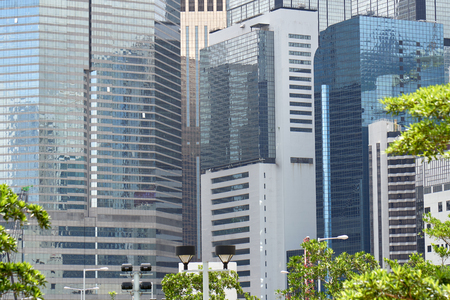 HONG KONG - July 4, 2018: Cityscape with skyscrapers and high-rise office glass and steel buildings. Concrete jungle. High density development. Urban architecture.