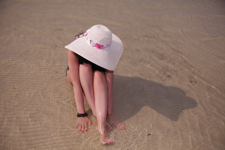 Attractive girl in the hat sidin on page in water Stok Fotoğraf - 36268798