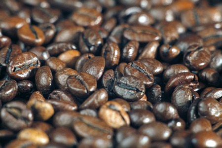 Roasted coffee beans on the table closeup Stok Fotoğraf