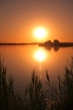 garish: Sunset on the lake. Romantic beautiful evening on the nature Stock Photo