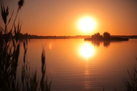 garish: Sunset on the lake. Romantic beautiful evening on the nature Stock Photo