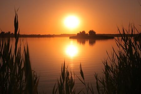 Sunset on the lake. Romantic beautiful evening on the nature Stok Fotoğraf - 41048815