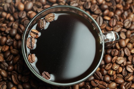 Glass Cup With Coffee Beans Roasted Coffee. Close-up