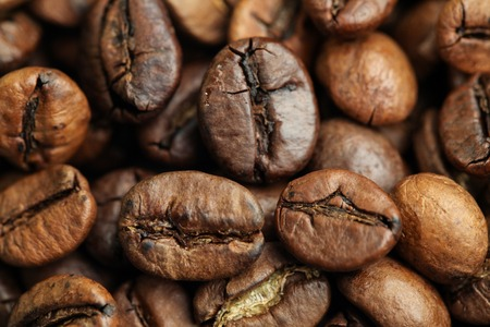 A Bunch of Roasted Coffee Beans on The Table. Close-up