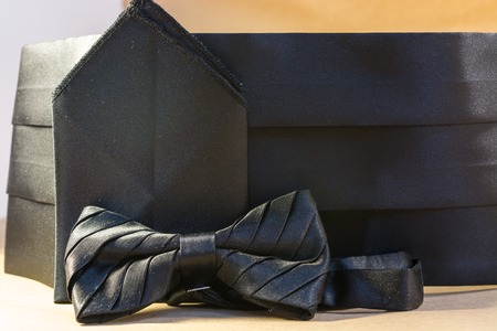 Black bow tie with a sash and a handkerchief for a suit for the evening ball Stock Photo