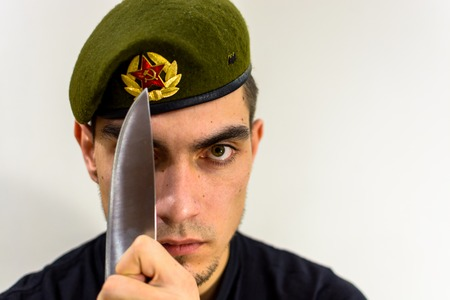 young soldier in a green beret intelligence Stock Photo