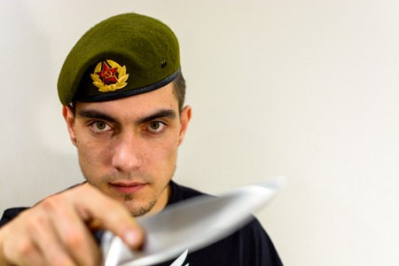 military green beret with a knife intelligence Stock Photo