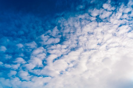 Blue sky with clouds. Winter day. tinted Stock Photo