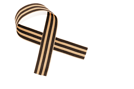 St. Georges ribbon isolated on white background. The symbol of the great victory of May 9. toned