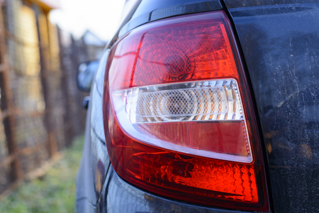 alloy: Red taillight of the black car close-up Stock Photo