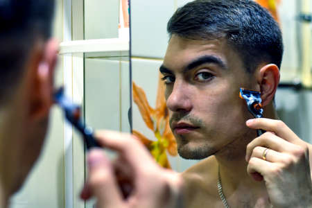 The man in front of a select electric shaver or razors classic. authentic