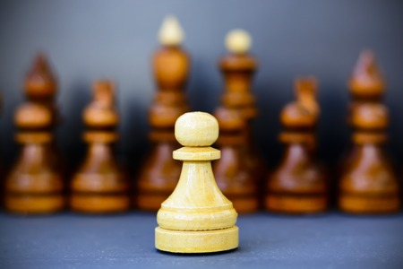 the strongest: Concept of leadership, success, motivation. Chess pieces on the Board