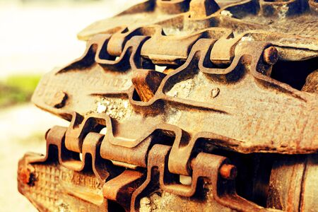 Continuous caterpillar tracks of the bulldozer. Close up. detail of a rusty tractor tracks Stock Photo