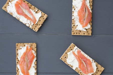 caper: Healthy lunch, of crispbread with fish, cream cheese and greens