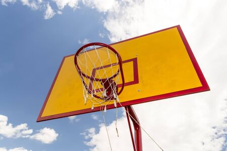 Bottom view of Basketball hoop with blue sky background. Stock Photo
