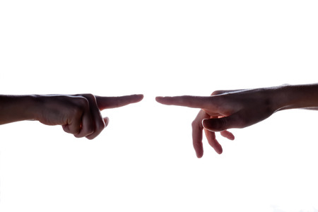 Isolated image of a silhouette of the boys hands reaching for the womans hand. Hands of mother and son. The concept of family, support, help, love Stock Photo