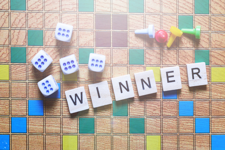 Board games. The winner of the game. game cubes and chips on the canvas