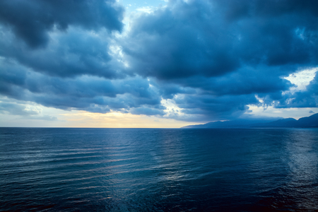 Cloudy grey cloud on the gloomy sky before a thunderstorm. Stock Photo