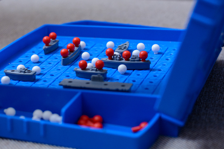Game-battleship closeup. Toy warships and submarine are placed on the playing field. concept-strategy, thinking, victory, defeat.