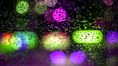 image rain drops on the car window, the city lights at night in an abstract God in the background. shallow depth of field, grip, soft focus Imagens