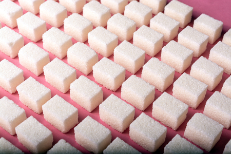 Geometric pattern with refined sugar on a pink background
