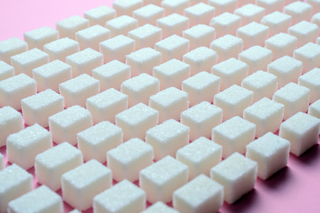 Pattern of white cubes of sugar on a pink background Banco de Imagens