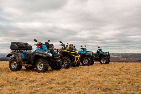 Dirty four Quad bikes in the field, adventure, rough terrain, extreme weekend Imagens