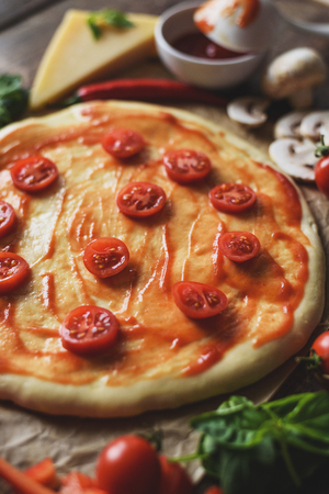 Classic pizza mozzarella with cherry tomatoes ,tomato paste and cheese, vertically.