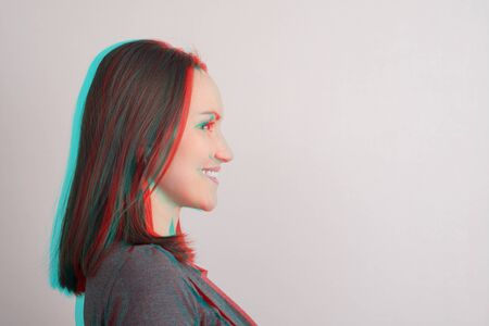 Close-up of young girl in profile,anaglyph effect, glitch, copy space