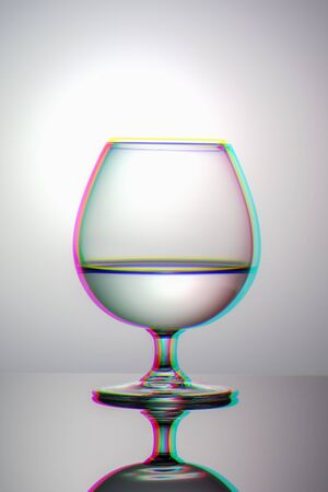 Minimalistic image of glass Cup with water vertical view, anaglyph and glitch effect