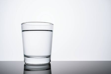 Glass Cup full of pure water with copy space. problems of ecology concept Banco de Imagens - 128654308