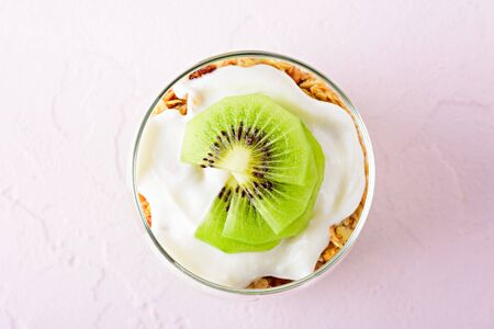 top view kiwi dessert in glass on pink background