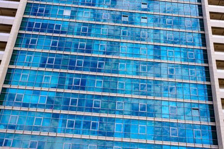 close up of multi-storey building with glass panoramic windows. modern building concept