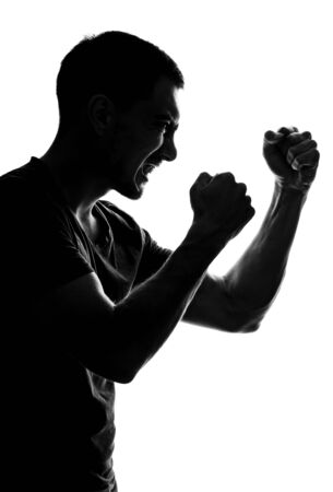 vertical silhouette of an aggressive man in profile with grin, fists folded in front of him, fighting stance