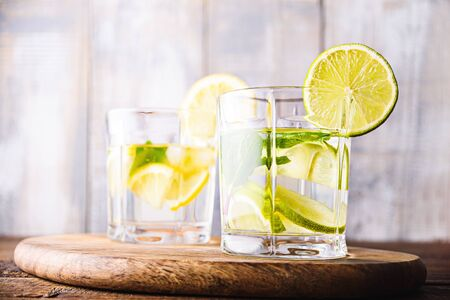 closeup refreshing homemade lemonade in glass glasses on grey wooden background