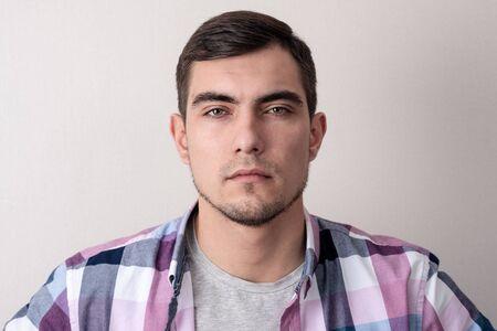 Portrait of young man with suspicious channels. shoulder portrait Stock Photo