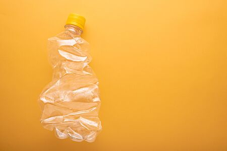 Recycling concept. top view Used plastic bottle for recycling with copy space, on yellow background Stock fotó