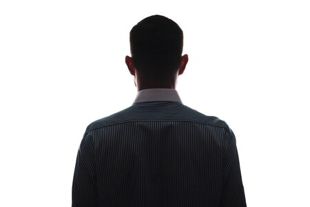 Silhouette of man frontally from the back in business shirt