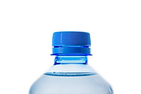 Macro close-up of the neck of blue plastic bottle with clean water horizontal position, isolate on white background Stock fotó