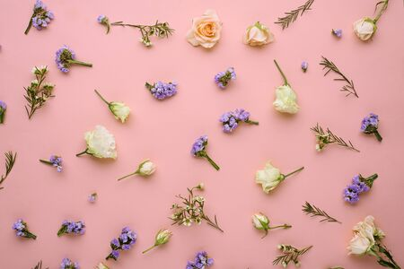 flower composition, roses, eustoma, limonium on pastel pink background, flat lay, top view, spring concept Reklamní fotografie