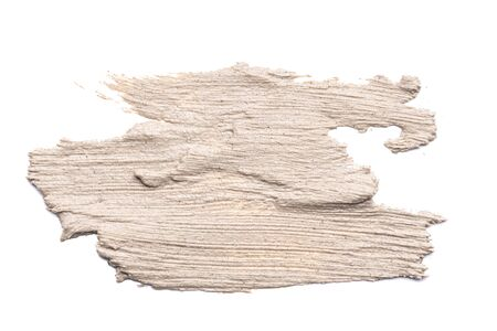 beige clay mask, smear stroke on white background, scrub texture, skin cleansing, copy spce